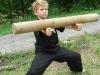 rolování dřevěného kůlu na předloktí (jong gung)